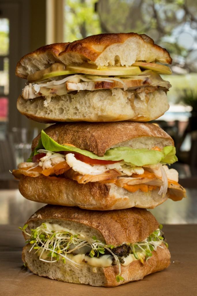 Sandwich pile-up; (TTB) Pork Sandwich, Turkey Sandwich, and Vegetarian Jerk Mushroom sandwich by Sassafras Bakery. Shot 05/07/15 at Sassafras Bakery in Worthington, Columbus for Alive Eat & Drink Feature. (Meghan Ralston)